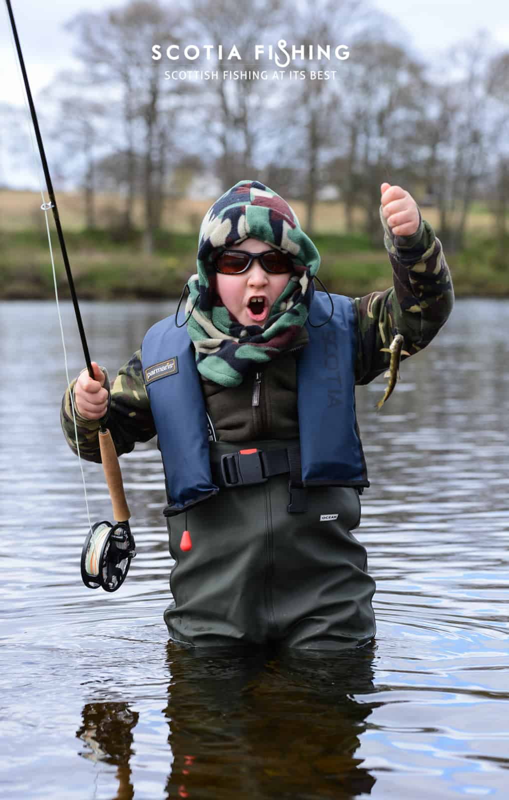 young-angler-with-first-ever-trout-on-the-fly